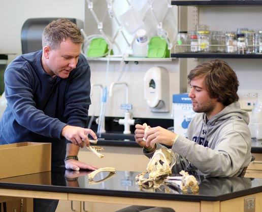 Student and professor in science lab